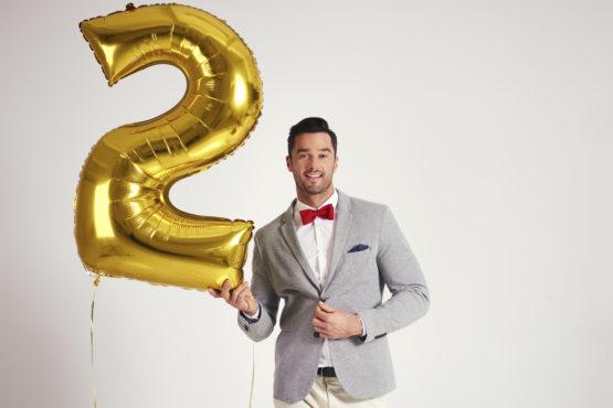 Golden Birthday Gift Ideas - A person holding a golden balloon